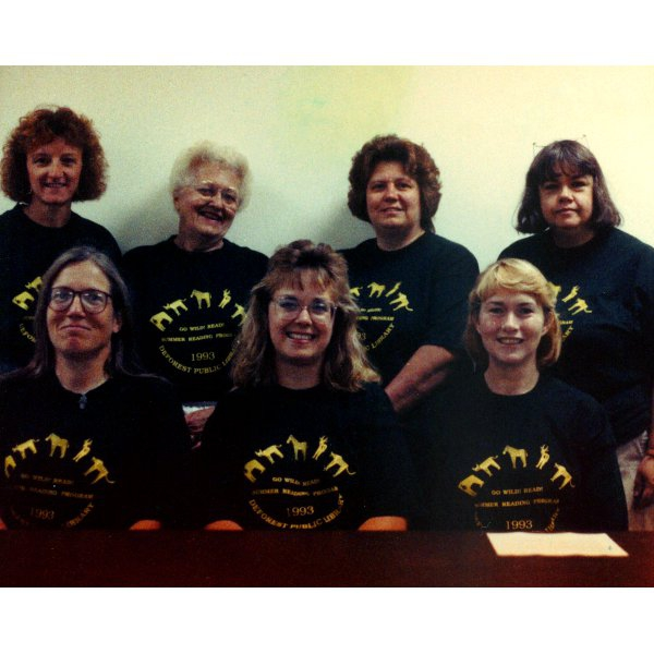 1993 - Library Staff - Back Row: Marie Campbell, Arline Johnson, Louise Valdovinos, Judy Ecker - Front Row: Jan Berg, LuAnn Norton, Sharon Grassee - Summer Reading Program: Go Wild Read!